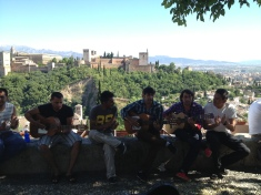 Flamenco street performers in Granada, with Alhambra providing a stunning backdrop