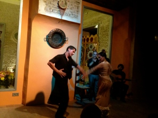 Dancing the Flamenco at an intimate theatre in Seville.