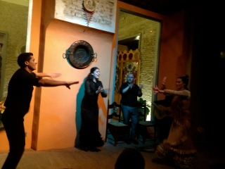 The woman singing Flamenco, while other members of her family dance.