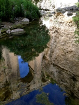The new bridge reflected in the waters below, Ronda