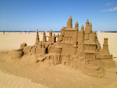 A form of beach busking, this sand castle took the designers a week to build. It must be kept wet all day to protect it from crumbling and they guard them at night.