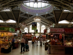 The food markets in Valencia are housed in an ornately designed building.