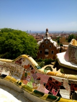 Gaudi's work on display at the Park Guell, against a city backdrop.