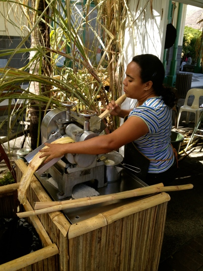 Squeezing fresh sugar cane juice at the marina in Port Louis.