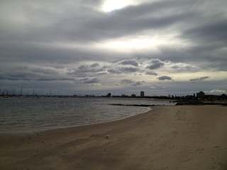 Views from one of the St Kilda beaches back to Port Melbourne and a dramatic winter sky.