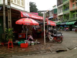 An open-air spot to do the dishes in downtown Phnom Penh.
