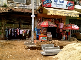 In typical Cambodian spirit, this shop seems to be carrying on with business as usual despite the fact the street and drains in front are all ripped up.