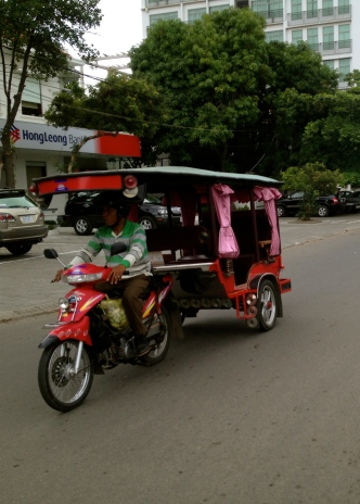 Tuk tuks come in all colours and conditions. The pink curtains on this one catch the eye.
