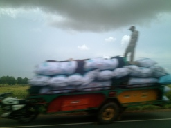 This is the blurriest of all my highway pictures but I had to include it because: 1) there's a man standing up as this load cruises down the highway at speed and 2) it looks like there's nobody driving it. At least one of these things is only an illusion.