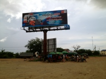 This billboard forms a rendezvous point for locals in this little town.