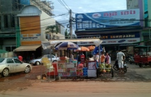 This stall is a local petrol station. The stand on the left holds old cool drink bottles filled with fuel.