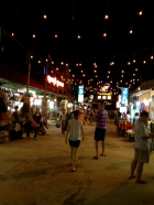 Once dark local streets, the path from Pub Street to the Night Market in Siem Reap is now an unbroken series of stalls and neon lights.