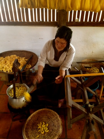There are dedicated enterprises that seek to teach and preserve the traditional methods for arts and crafts, including the production of silk as being practiced here.
