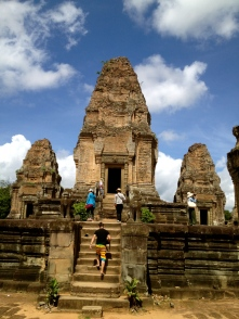 Tourists explore the East Mebon temple ruins.