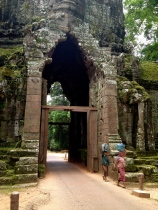 Many aspects of life for the local people go on as they have for centuries. These women are walking near the wall of Angkor Thom, the last capital city of the ancient Khmer Empire.