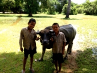 These two boys were herding their water buffalo in the grounds of the Prea Rup temple ruin. We first spotted them from high on the temple, where we could see the water buffalo enjoying a refreshing dip in the deep pools of water created by the wet season.
