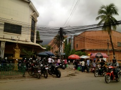 Local people get on with life under the wires, which seem to just blend into the scenery for them.