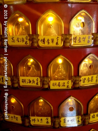 A series of miniature Buddhas with their own lit cabinet form a colourful tribute in the Xie Tian Gong temple in Phnom Penh.