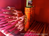 Incense sticks on the shelf form a colourful display at the Xie Tian Gong temple, Phnom Penh.