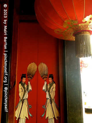 Images on the threshold of the Xie Tian Gong temple entrance, Phnom Penh.