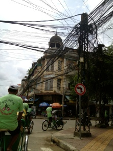 I usually try hard to avoid getting all the wires in photos, but this was such a classic shot - the cyclos, the wires, the historic Hotel International building in downtown Phnom Penh.