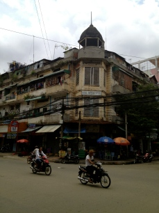 Built circa 1905, the Hotel International building in Phnom Penh was taken over by squatters in the years after the downfall of the Khmer Rouge in 1979. Like many buildings during this period, squatters built shacks across the rooftop which are visible in this picture.