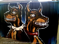 These ferocious looking guys are painted on the gates of someone's suburban driveway.