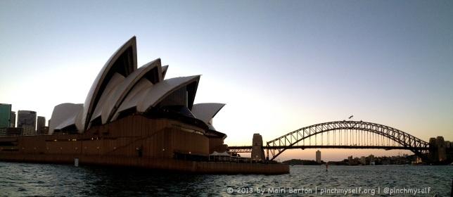 Sydney Opera House and Sydney Harbour bridge at dusk.