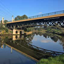 The MacRobertson bridge over the Yarra River, with sky reflected on water